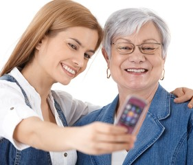 Mother and daughter photographing themselves