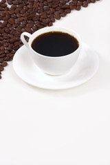 Cup of coffee with grains on a white background
