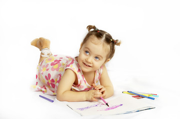 The beautiful girl drawing pencils in a sketch pad on the isolat