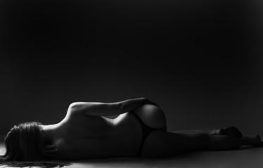 classic low key photo of sexy woman body