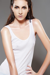 Beautiful fashion slim wet woman model in white blank t-shirt