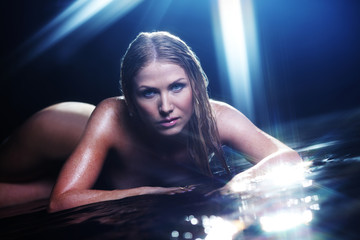 nude woman in water sudio