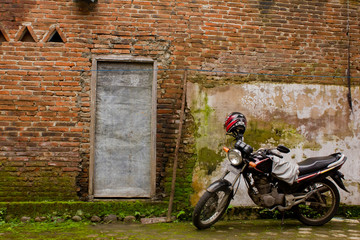 Motorcycle near brick wall