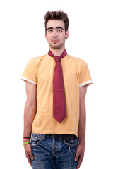 young man with a tshirt and a tie, making a funny face