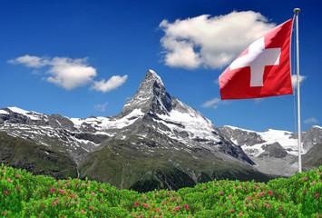 Beautiful mountain Matterhorn with Swiss flag - Swiss Alps Wall mural