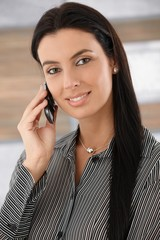 Portrait of beautiful woman on phone smiling