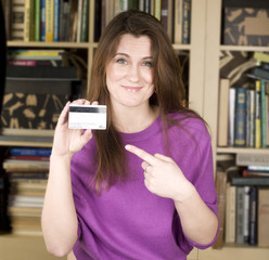 portrait of pretty student with plastic card