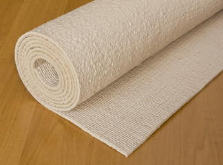 rolled up execise mat used for yoga or pilates