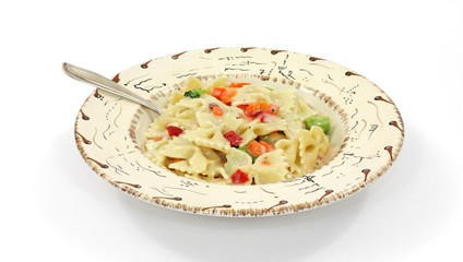 Pasta Primavera in southwestern style bowl with fork