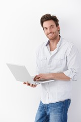 Handsome man with laptop smiling