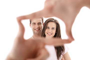 Hands imitating frame for couple photo
