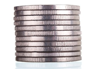 Silver coins stack on white