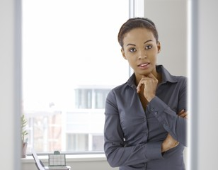 Portrait of young afro-american woman in office