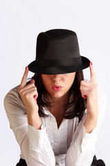 Young woman hiding her face under the hat's brim