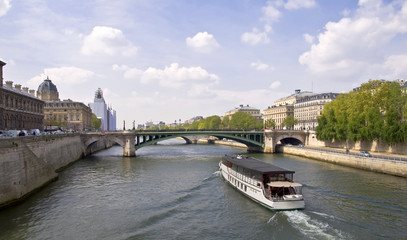 Passenger ship boat sails on the river Seine. Paris