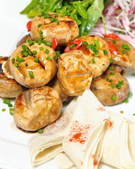 potatoes in their skins with garlic,pita
