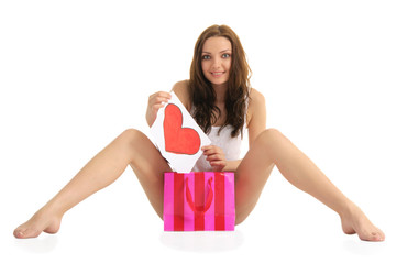 sexy young woman with painted heart and gift bags