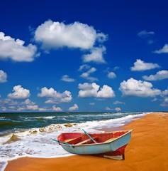 oared boat on a sea coast