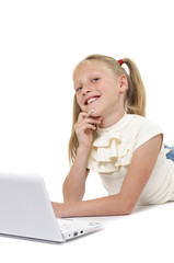 Happy and smiling little girl with laptop