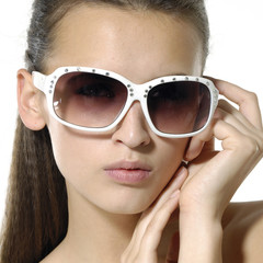 Close up fashion model wearing the big modern sunglasses.