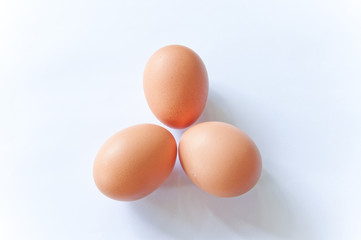 close up three hens eggs on white background
