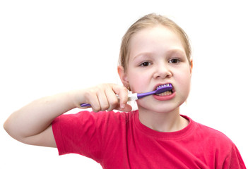 The girl brushes teeth a tooth brush