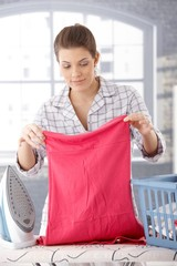Smiling woman doing housework