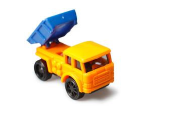 Plastic toy truck isolated on white background
