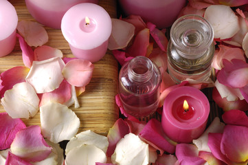 Aromatic candles and petals of roses