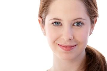 Closeup portrait of natural beautiful face smiling