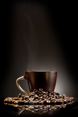 brown cup of coffee with beans over gradient background