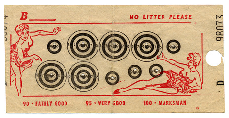 Fairground targets with bullet holes