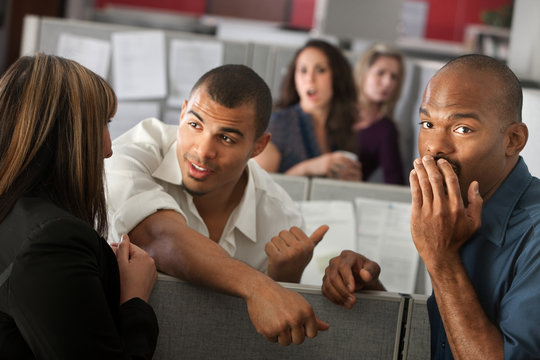 Embarrassed Man With Coworkers