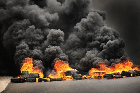 explosion & burning wheels causing huge dark smoke &  pollution