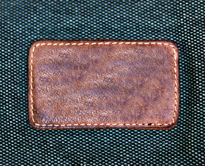 Rectangular leather label isolated over denim texture