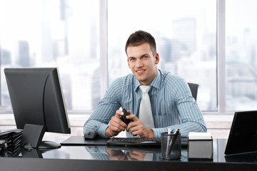Young manager smiling at desk