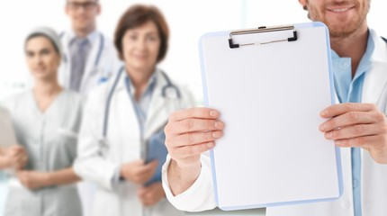 Closeup of blank clipboard held by doctor