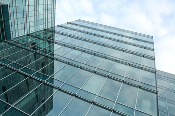 blue glass wall of modern building
