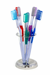 five toothbrushes in a steel holder