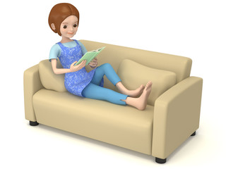 ソファでくつろぎながら読書をする女性