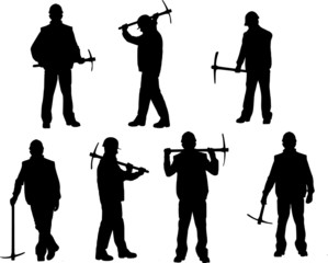 Silhouettes of building worker with pickax