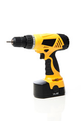 Yellow power drill isolated against white