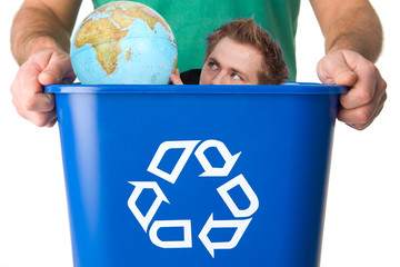Man with globe in garbage for recycling