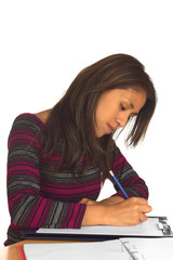 Young Peruvian woman writing with a pencil on white paper
