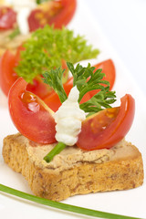 Appetizers with pate, decorated with tomato and parsley