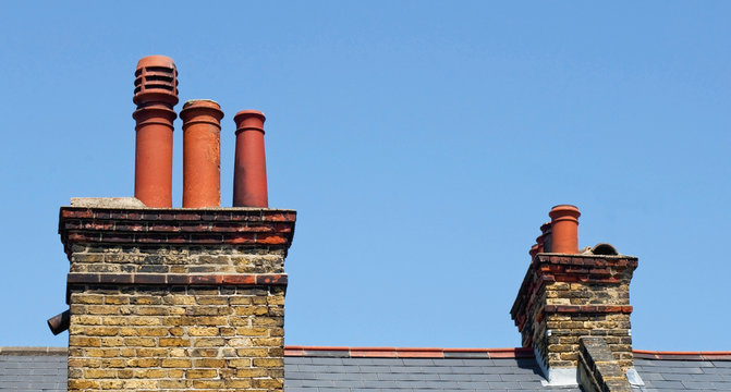 Chimney stacks on the roof of a victorian terrace house