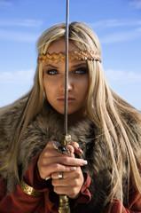 Viking girl warrior on a blue sky background