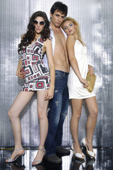 Fashion photo of handsome man and two women shot in studio