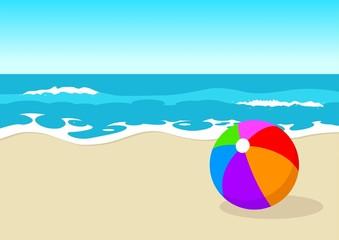 Colourful ball at the beach