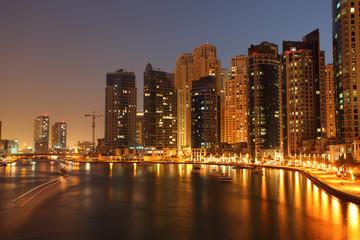 Highrise buildings at Dubai Marina illuminated at night